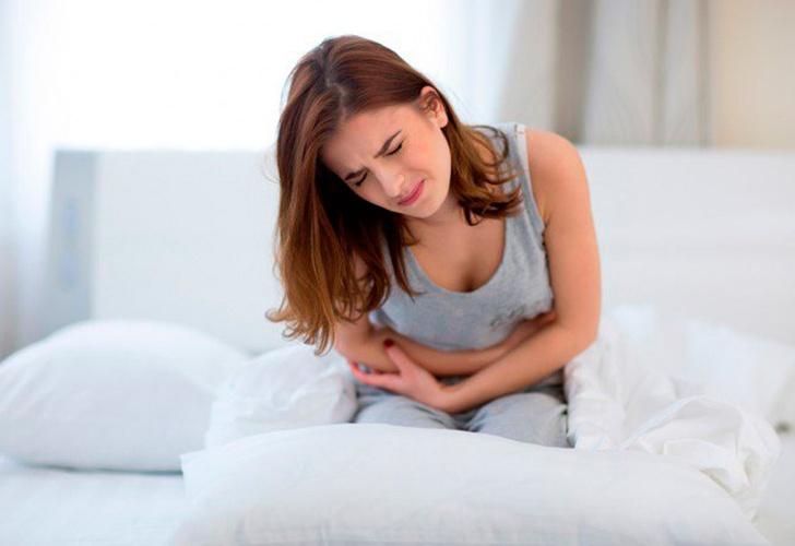 боль внизу живота у женщин при аллергии